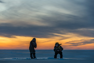 Ice fishers at dusk