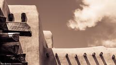 Santa Fe Adobe (Thad Zajdowicz) Tags: zajdowicz santafe newmexico leica availablelight outdoor outside lightroom building architecture sky clouds sepia monochrome americansouthwest background wallpaper light shadow adobe wall