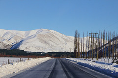 Icy Road - Beautiful Scenery (flying-leap) Tags: winter light newzealand snow mountains rural canon landscape shadows nz southisland farms 4winter highcountry midcanterbury 18200mm the4seasons 60d canon60d nzhighcountry mtsomershakaterecorner