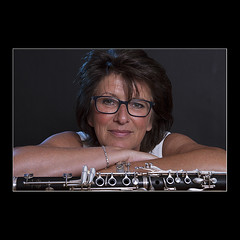 The clarinet player (KoenK68) Tags: portrait music woman blackbackground comfortable female studio glasses pretty flash instrument brunette woodwind clarinet ease koenk68
