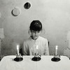 I whisper to the light (Dara Scully) Tags: child children candle light invocation play game portrait blackwhite darascully childhood mirror suggestive white purity pure film square analog analogic