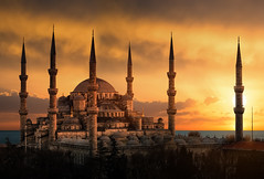 The Blue Mosque in Istanbul during sunset (jerekhough) Tags: istanbul blue turkey sultanahmet islam tower oriental turkish mosque landmark architectural middle orient minaret dome clouds building asia ottoman basilica bosphorus historic roof heritage famous architecture temple sky tourism religion islamic ancient silhouette monument arabic eastern muslim asian landscape sun sunset flare