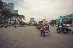Bucking the trend (meezoid) Tags: cyclist traffic roundabout vietnam asia hochiminh saigon urban street road travel