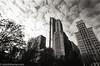 Clouds (johnlishamer.com) Tags: 2016 2017 35mm bw ddx ilfordhp5plus400 lishamer michiganave millenniumpark nikonfa slr chicagoil city cityscape film johnlishamercom orangefilter pushedto800 skyscrapers urban winter