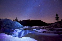 Elbow Falls January Night (John Andersen (JPAndersen images)) Tags: alberta elbowfalls forest kananaskis lightpainting longexposure milkyway night sky snow stars waterfall winter