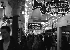 Market Grill (Christine Marie Gordon) Tags: blackandwhite pikeplace seattle market grocery shop street outdoors city candid lights work meat seafood food neon sign walking