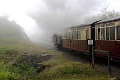 Fairlie 'Merddin Emrys' disappears into the low cloud at Tanygrisiau with a train for Porthmadog on 20th June 2015 as it passes Pen Stock Rd LC.  (steamdriver12) Tags: road park summer cloud heritage june wales train pen crossing smoke low north stock railway steam national level preserved coal snowdonia gauge narrow 20th passes emrys ffestiniog gwynedd porthmadog fairlie 2015 tanygrisiau into merddin dissapears 111