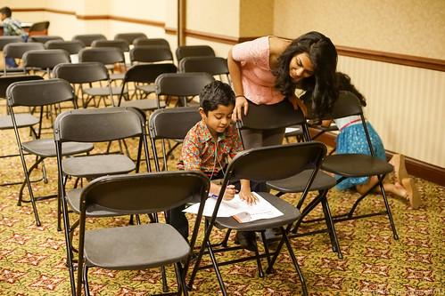Children doing workbook exercise