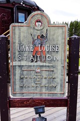 Lake Louise Station (Patricia Henschen) Tags: lakelouise depot train station canadianpacific railroad alberta canada mountains clouds canadian rockies rocky banffnationalpark parks parcs parkscanada railroadstation railway boreal forest cp rail sign