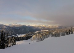 Sun breaks through the clouds (Ruth and Dave) Tags: whistler whistlermountain whistlerblackcomb clouds sky sun sunshine weather weatherphotography snow piste skirun skiresort trees forest mountains