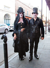 Gothic Couple in Costume (shaire productions) Tags: nola neworleans travel image picture city urban street photo pic photograph outdoor frenchquarter artistic people person streetphotography man woman couple goth gothic halloween dayofthedead costumes elegant black attire hat fashion zombie voodoo undead vampire creatures