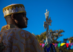 Ethiopian orthodox priest with a cross celebrating the colorful Timkat epiphany festival, Amhara region, Lalibela, Ethiopia (Eric Lafforgue) Tags: adult africa africanethnicity amhararegion celebration ceremony christian clearsky colourpicture copticchristianity copyspace cross culture day developingcountry eastafrica epiphany ethio17429 ethiopia ethiopian horizontal hornofafrica humaninterest lalibela multicoloured onemanonly oneperson ornate orthodox outdoors people photography pilgrimage priest religion religious religiouscelebration semienwollo timkat togetherness traditionalceremony traditionalclothing traveldestinations unescoworldheritagesite et