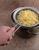 Cooked tagliatelle in a sieve. (annick vanderschelden) Tags: emiliaromagna italiancuisine italy marche sicily baking boiling brown cereals cooked cut dish dough dried durum egg eggpasta eggs flat flour food fresh grains hand handle humanhand long noodle pasta pastafresca pastasecca porous ribbons rough semolina shapes sieve staplefood tagliatelle tagliolini traditional unleavened water wheatflour yellow