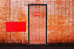 Emergency Exit (ElseKramer) Tags: door red urban 15fav brick amsterdam wall contrast 510fav d50 catchycolors nikon exit nikkor emergency fragments ojp elsekramer 35mmf2d