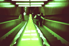 riding down the middle (poopoorama) Tags: seattle 15fav green film tag3 taggedout washington lomo lca xpro tag2 tag1 kodak crossprocess library escalator ektachrome e200 letsplaytag