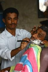 Man being shaved at the barber's - Yemen (Eric Lafforgue) Tags: voyage travel republic middleeast arabic arab arabia yemen arabian sanaa ramadan yemeni yaman middleast arabie moyenorient jemen lafforgue arabiafelix  arabieheureuse  arabianpeninsula    ericlafforgue iemen lafforguemaccom mytripsmypics imen imen yemni    jemenas    wwwericlafforguecom  alyaman ericlafforguecomericlafforgue contactlafforguemaccom yemenpicture yemenpictures