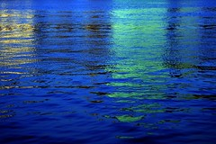 indigo (Farl) Tags: nyc morning blue sea usa ny newyork reflection colors skyline sunrise buildings reflections river us shadows manhattan midtown queens un unitednations waters ripples chrysler gantryparkstateplaza