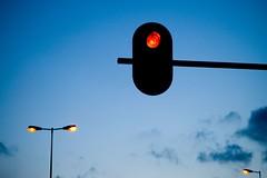 Twilights (ElseKramer) Tags: street blue light red 15fav orange black car amsterdam clouds d50 grey lights twilight nikon shot traffic dusk roundabout nikkor amstel elsekramer 55200mmf456g