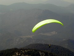Into the void (mind the goat) Tags: mountain sport yellow topv111 tag3 taggedout turkey tag2 tag1 air paragliding paraglider pilot