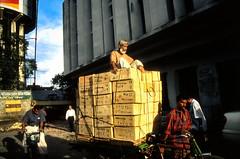 Street life in Dhaka (A look through lens) Tags: people man men canon asia transport streetphotography streetlife photoblog velvia dhaka photolog fujichrome canoneos bangladesh bengali analogic