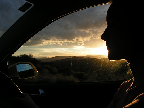 kristen driving at sunset