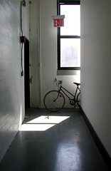 Escape Route (Hoot Owl) Tags: light shadow window bicycle escape hallway doorway exit exitsign firestairs escaperoute patchoflight