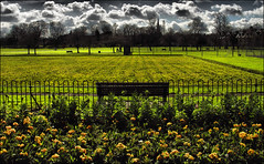 . The Park . (3amfromkyoto) Tags: park uk flowers cambridge england people woman baby man green bench cyclist jesus 2006 flowerbed bowling april cambridgeshire 3amfromkyoto flickr:user=3amfromkyoto