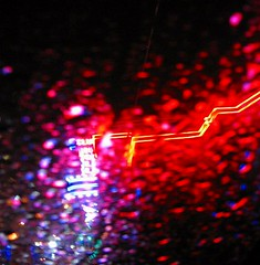 neon rain (sophiacreek (again)) Tags: availablelight blurr catchycolor catchycolors color drive neon night purple rain red reflection rouge seattle shine stg washington weather zoom 15fav wonder great beautiful 123 1on1 tag1 tag2 31 100v tag3 taggedout