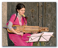 She was playing Bach... (lapidim) Tags: espaa music spain topv333 bach toledo instrument strings nyckelharpa gtaggroup