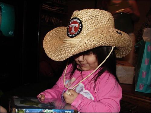 girl 2005 child toddler playful cute handful cowboy cowgirl hat cowboyhat