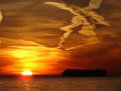 Coney Island II (Diego3336) Tags: ocean nyc winter sunset sea sky usa sun ny newyork reflection beach water brooklyn america reflections coneyisland island boat twilight contrail ship dusk trails trail bklyn coney chemtrail contrails brightonbeach chemtrails vapourtrail vapourtrails condensationtrail
