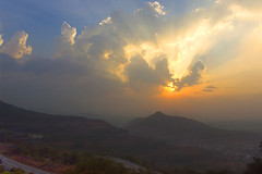 Sunbeams at Lonavla (Anindo Ghosh) Tags: sun india nature colors beautiful topv111 clouds landscape cool highway indian hills cumulus maharashtra lonavla sunbeams continuum anindo 333v3f greatsky anindoghosh