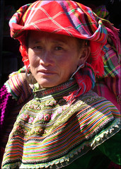 Portraits of the Hill Tribes: Flower Hmong (mboogiedown) Tags: travel woman flower beauty bravo asia market traditional hill vietnam tribes ha sundaymarket  sapa hmong hilltribes bac  theface   bacha flowerhmong   bachamarket ethinicminority
