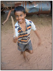 Play Fighting Boy. Agonda, Goa. (kastakephoto) Tags: travel friends boy portrait people sun india holiday hot travelling boys smile face canon fun sand hands friend asia top20portrait photographer village play indian goa powershot grin dust s50 kas top201