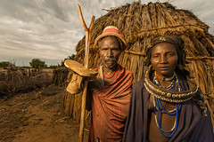 The Arbore Elders (Omo Valley, Ethiopia) (Alex Stoen) Tags: africa travel vacation portrait canon geotagged parents google couple flickr african culture hut tribes omovalley tradition ethiopia elders et smugmug facebook natgeo creativelighting arbore pocketwizard nationalgeographicexpeditions 1dx offshoeflash ef1635f28liiusm alexstoen alexstoenphotography canoneos1dx