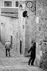 Don't Look Now (fran-taylor) Tags: street blackwhite spain nikon streetphotography runningaway caceres oldcitywalls frantaylor frantaylorphotography crouchingmonkeysign