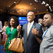 USAID Acting Administrator Alfonso Lenhardt holds hands with YALI participants