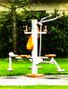 Weight Lifting (Steve Taylor (Photography)) Tags: excercise machine equipment apparatus art design digital park brown green white orange metal plastic newzealand nz southisland canterbury christchurch hagleypark grass tree hedge rain