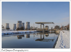 Barnby Dun, South Yorkshire (Paul Simpson Photography) Tags: thorpemarsh coolingtowers paulsimpsonphotography natire canal southyorkshirenavigation southyorkshire waterway powerstation february2012 snow winter bluesky reflections waterreflections bridge barnbydunn village transport imagesof imageofphoto photosof viewsof industry industriallandscape
