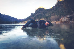 Lightheartedness (Stefan (ON/OFF)) Tags: pov perspective pointofview lowpov icy frozen lake hintersee berchtesgadenerland reflections reflection fun kid son kind spass mountains berg berge alpen alps smile eyes sonya7 sonya7m2 sonya7ii sigmaart2414 sigma sigmamc11