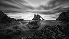 Bow Fiddle Rock (Snowblind6 Photography) Tags: bow fiddle rock portknockie buckie schottland vereinigtes königreich bowfiddle snowblind6 snowblind scotland rocks sea waves vacation nordsee felsen meer wellen urlaub north clouds bw black white nd neutraldichtefilter neutral density loch hole water wasser mist nebel wet canon tamron 15mm nd3 langzeitbelichtung long time exposure gb