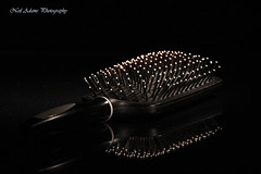 Hair brush (Neil Adams Photography (Wirral)) Tags: hairbrush brush reflection circles spherical lowlight low light key lowkey canon shadow studio stilllife