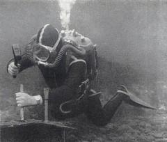 Vintage diver in yellow striped wetsuit. (Vintage Scuba) Tags: ocean lake man men wet water vintage belt tank mask smooth dry scuba diving rubber double hose suit diver beavertail weight drysuit fins wetsuit rebreather regulator