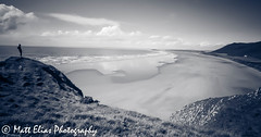 Rhossili is a little bit beautiful (mr_mattelias) Tags: sea sky people beach nature water monochrome beautiful swansea southwales wales landscape coast seaside sand view angle natural outdoor wide vista gower powerful conquer rhossili cliffface rhossilibay conquering