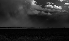 The storm lights its own stage (momrunninglate) Tags: clouds weather blackandwhite stormclouds stormy landscape kansas