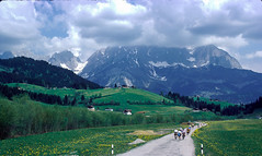 Heading for the hills! The road to Reith, Austria. (DP the snapper) Tags: view austria1976 spring touring flickposs cyclists chalet snow mountain