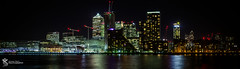 City. (Simon Rich Photography) Tags: panoramic canary wharf docklands river thames reflections city cityscape long exposure london buildings architecture lights simon rich simonrichphotography mrmonts canon