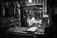 Chinese New Year Banner Maker, Chinatown, Singapore (KSAG Photography) Tags: blackandwhite singapore asia chinatown chinesenewyear trade market city urban travel adventure january 2017 street man person streetphotography