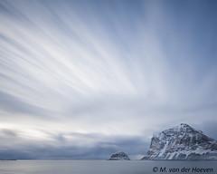 Pointing clouds (Monique vd Hoeven) Tags: lofoten noorwegen winter norway clouds longexposure le leefilters movement sea mountain coast emptiness blue utakleiv