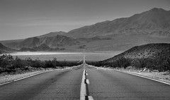 Miles and Miles of California Highway in the Mojave Desert (Black & White) (thor_mark ) Tags: avawatzpeak blackwhite blueskies californiastateroute127 capturenx2edited carsdriving colorefexpro creosotebush day5 desertlandscape drivebacktolaarea greatbasinranges highway hillsides kingstonrange lookingsouth mojavedesert mojavedesertranges mountains mountainsindistance mountainsoffindistance nature nikond800e northwestmojaveranges openroadahead project365 road saltbenchmark saltspringhillshighpoint stateroute127 triptodeathvalleyandcalifornia california unitedstates